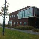 Glasbewassing Alpha Bedrijfsdeuren in Houten